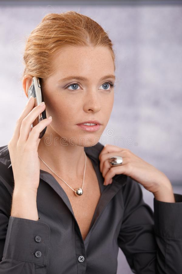 Young businesswoman concentrating on call royalty free stock images