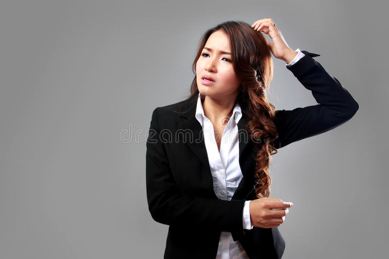 Young businesswoman confuse, stressed. A portrait of a young businesswoman confuse, stressed stock images