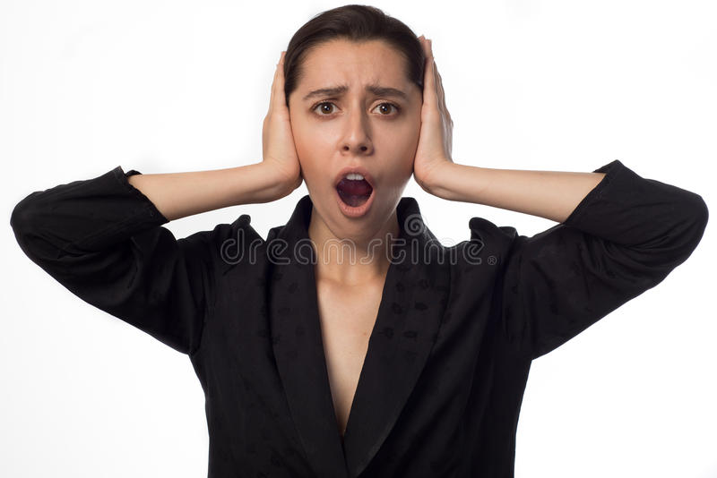 Young businesswoman covering her ears opened mouth royalty free stock photo