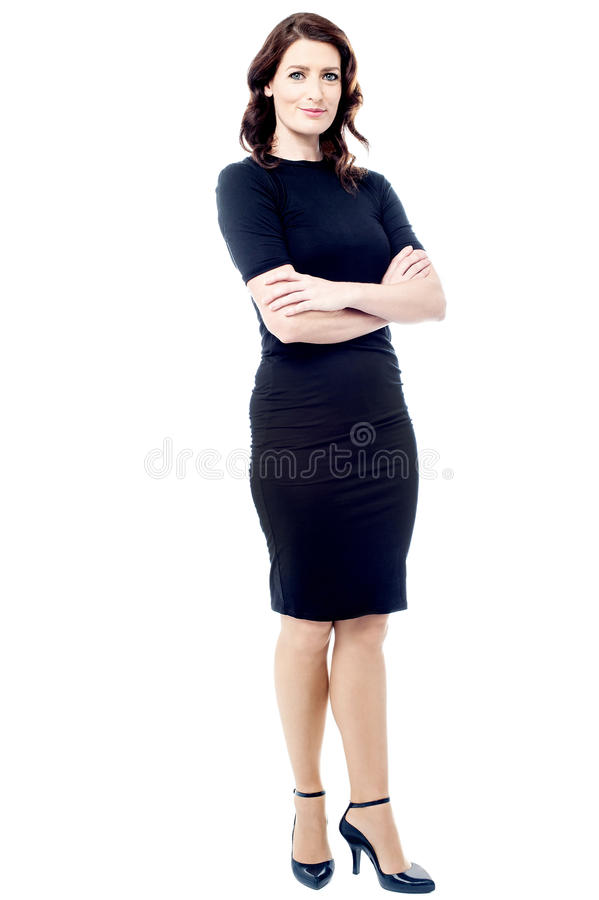 Young businesswoman with crossed arms. Attractive businesswoman standing with folded arms royalty free stock image