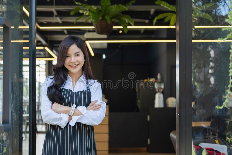 Young businesswoman with crossed arms standing near the office w stock image