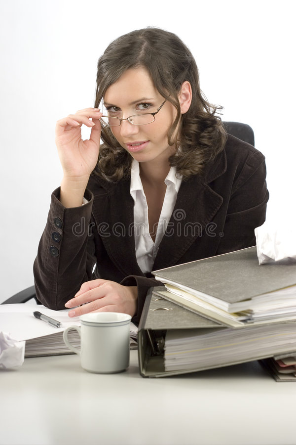 Young businesswoman at desktop royalty free stock image