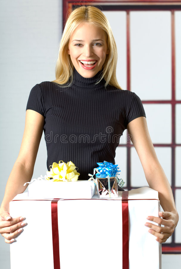 Young Businesswoman With Gifts Royalty Free Stock Image