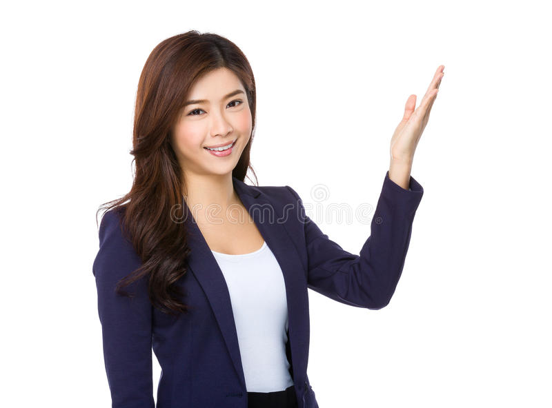 Young businesswoman with hand showing something. Isolated on white background royalty free stock image