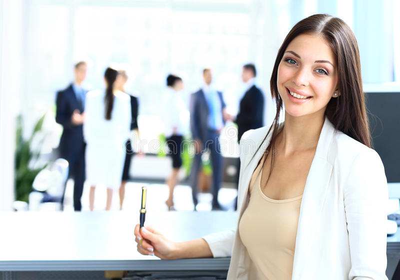 Young businesswoman. And her colleagues stock photography