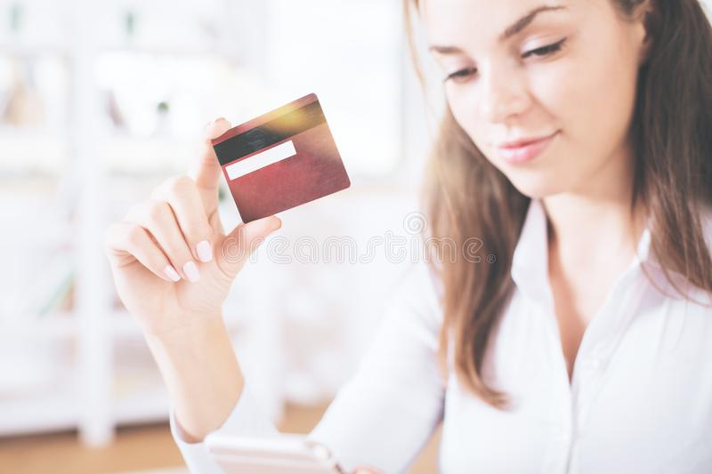 Young businesswoman holding credit card royalty free stock photo