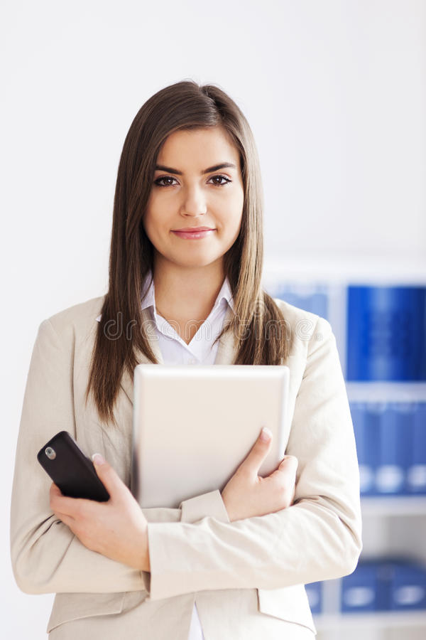 Businesswoman with tablet and mobile phone stock photo