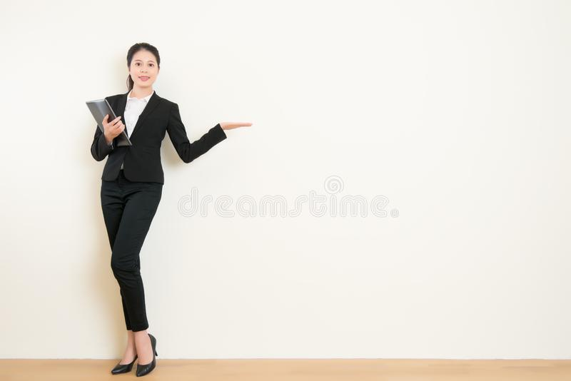 Young businesswoman holding pad tablet showing display royalty free stock photos