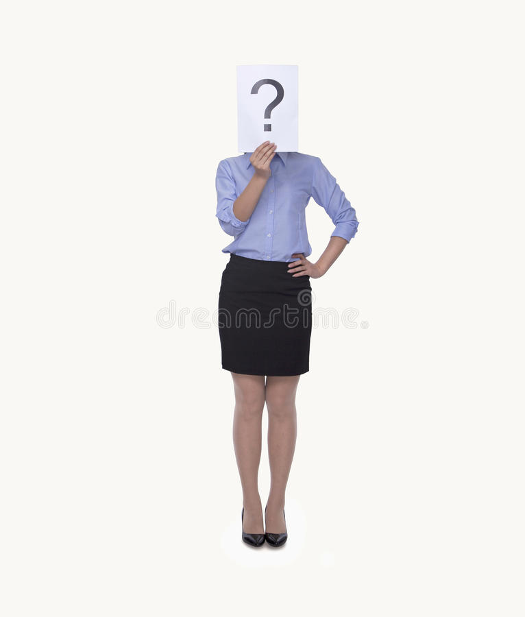 Young businesswoman holding at paper with a question mark on it, obscured face, studio shot stock images