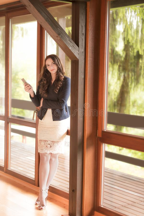 Young businesswoman holding phone stock image