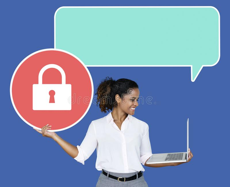 Young businesswoman holding a secured laptop royalty free stock photography