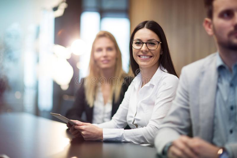 Young businesswoman holding tablet in conference room stock images