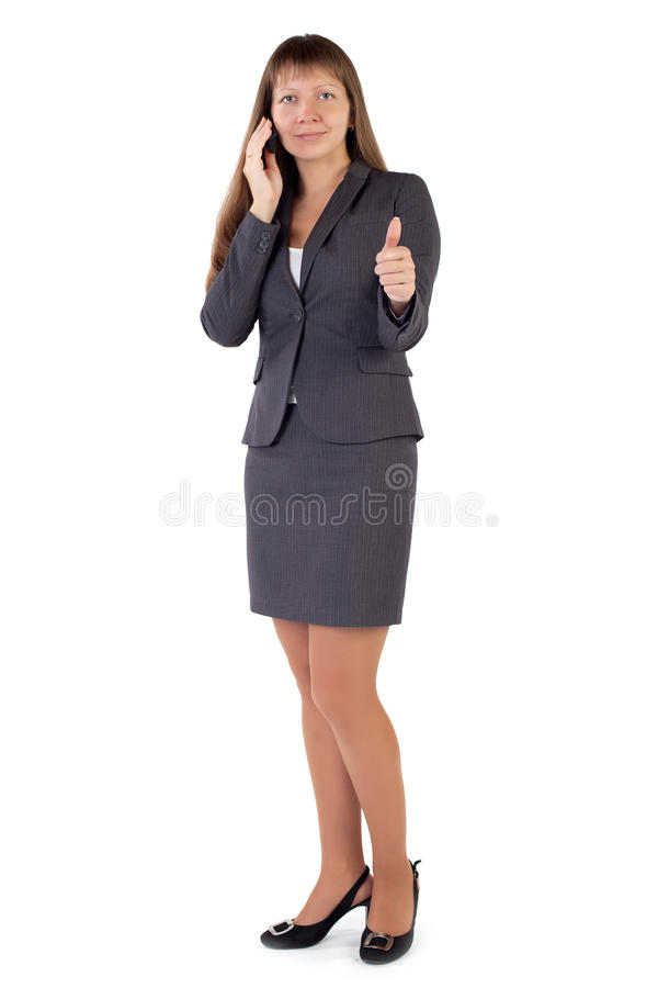 Young businesswoman holds his thumb up. Isolated white background stock image
