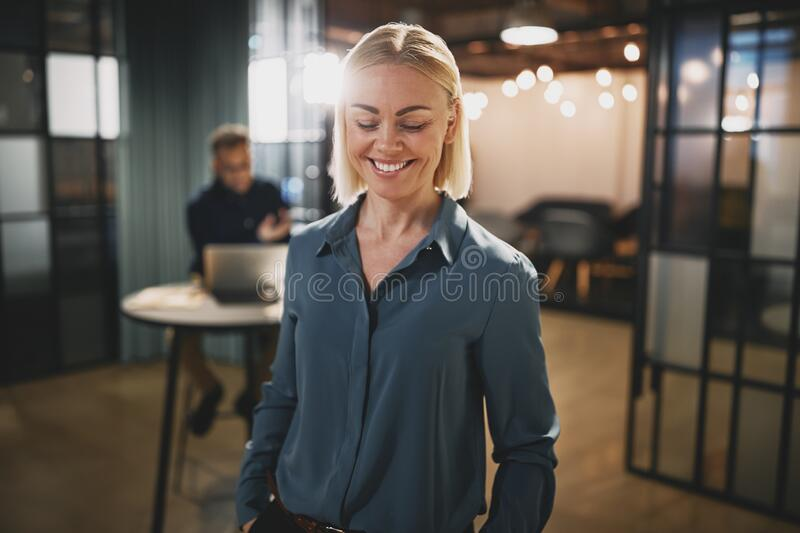 Young businesswoman laughing while working in an office stock photo