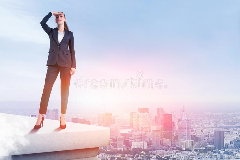 Young businesswoman looking forward on roof stock photography