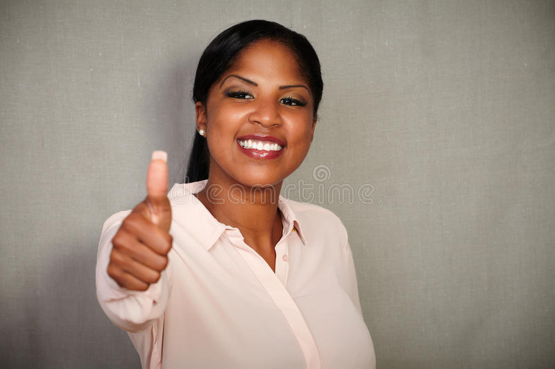 Young businesswoman making a good job gesture royalty free stock photo