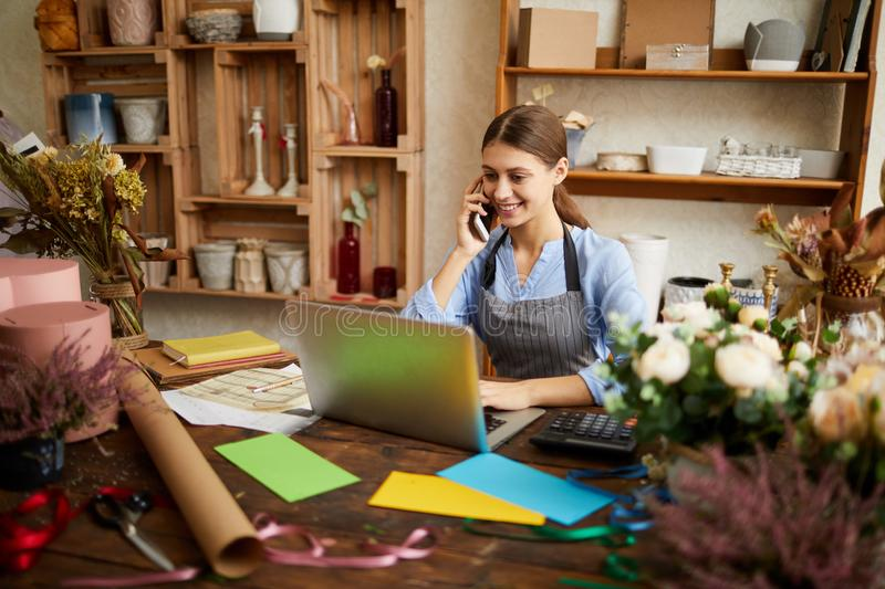 Young Businesswoman Managing Shop stock image