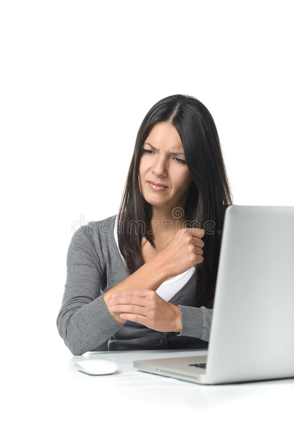 Young businesswoman massaging her forearm royalty free stock images