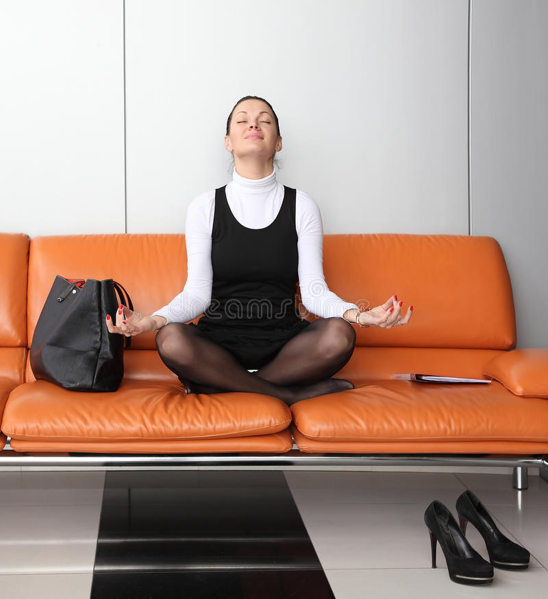 Download Young Businesswoman Meditating Stock Photo - Image: 24607442