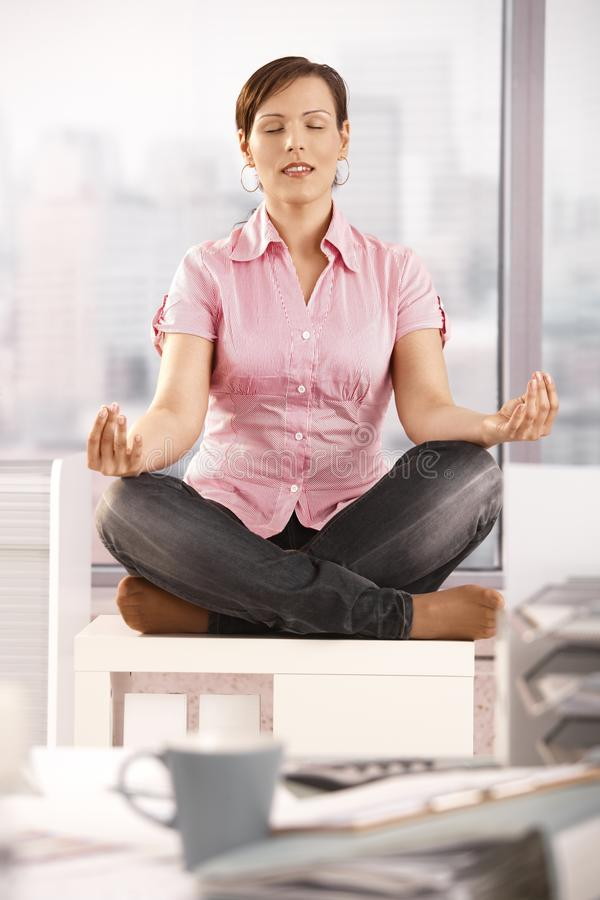 Download Young Businesswoman Meditating In Office Stock Image - Image: 17178143