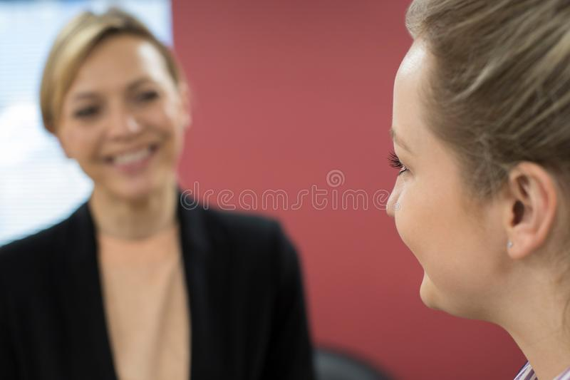 Young Businesswoman Meeting With Female Mentor In Office. Young Businesswoman Meets With Female Mentor In Office royalty free stock images