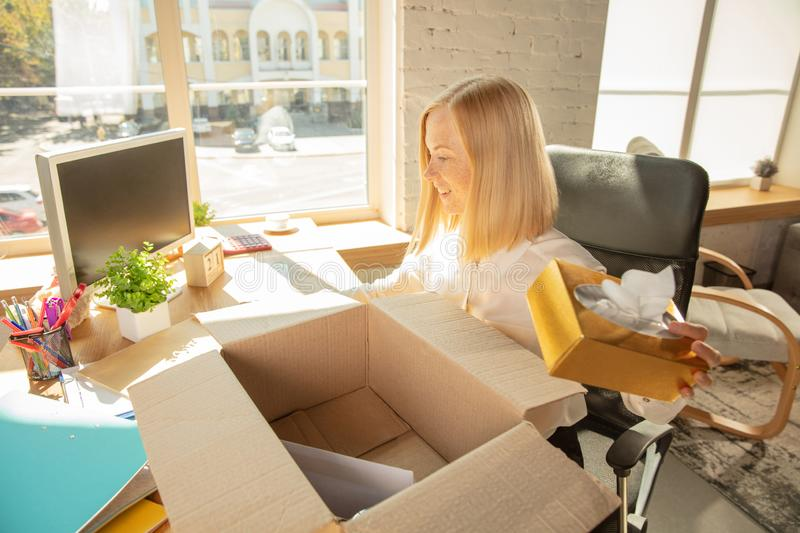 A young businesswoman moving in office, getting new work place stock photos