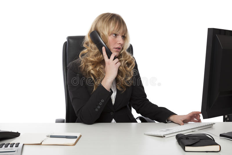 Young businesswoman multitasking royalty free stock images