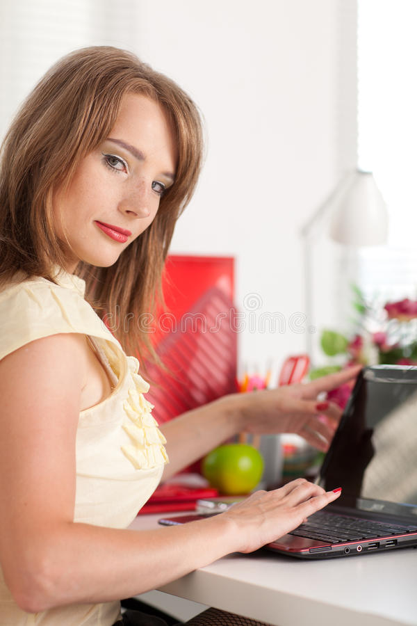 Young businesswoman at the office. royalty free stock photography