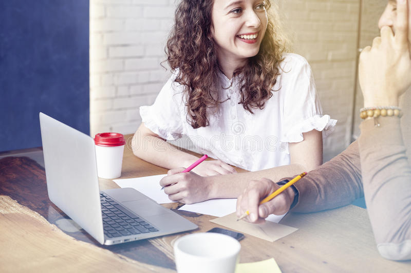 Young businesswoman with partners people gathered together, discussing creative idea in office. Startup concept coworkers meeting. royalty free stock photos