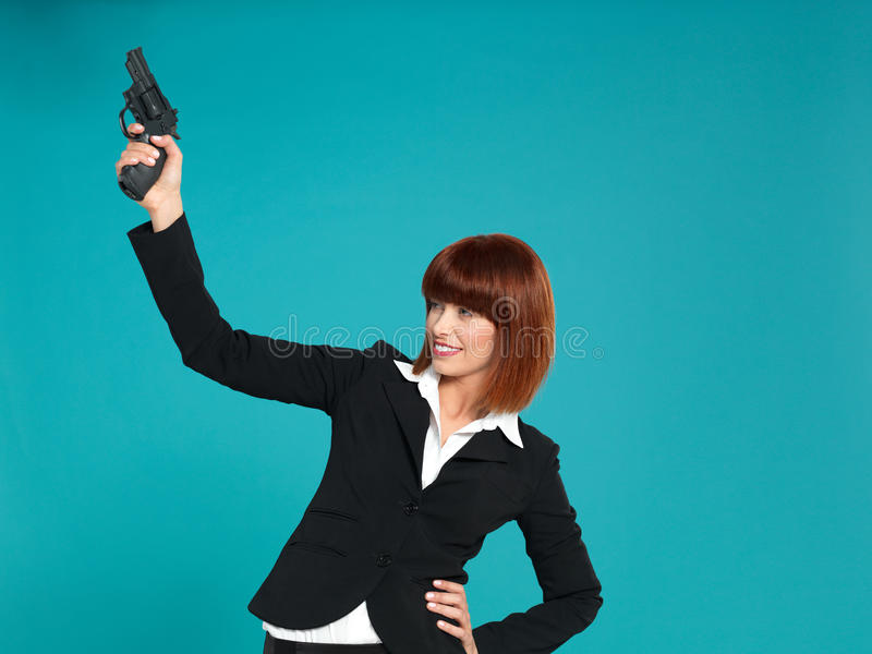 Young businesswoman, pointing gun in air royalty free stock photos