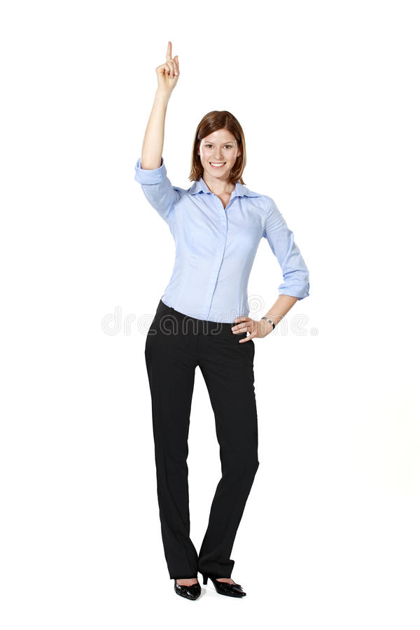 Young businesswoman pointing up stock photo