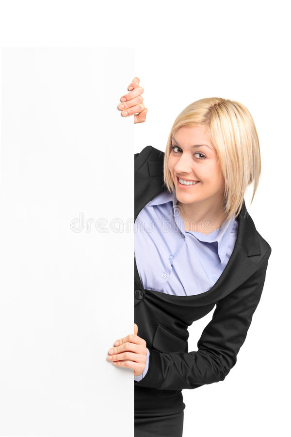 A young businesswoman posing behind a banner royalty free stock photos
