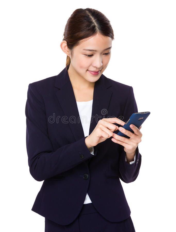Young businesswoman read on smart phone. Isolated on white background royalty free stock images