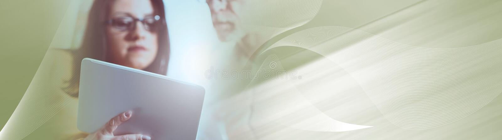 Young businesswoman and senior businessman working together, light effect. panoramic banner stock image