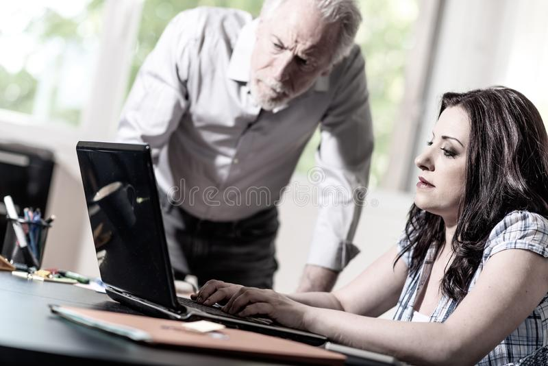 Young businesswoman and senior businessman working together stock images