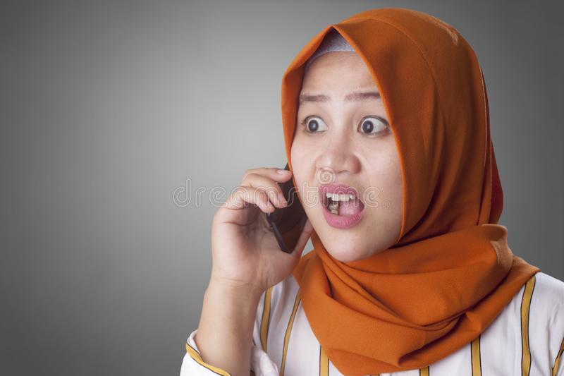 Young Businesswoman Shocked by Phone Call royalty free stock photo