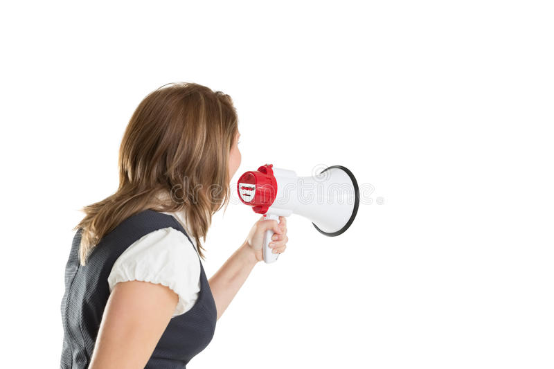 Young businesswoman shouting into bullhorn. Over white background stock images
