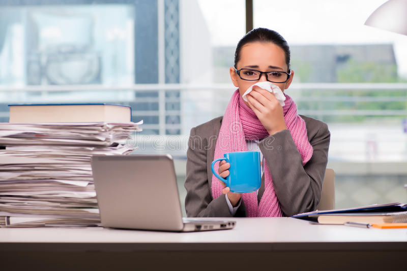 The young businesswoman sick in the office stock photos