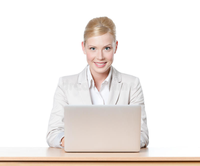 Download Young Businesswoman Sitting At A Desk With Laptop Stock Photos - Image: 25203973