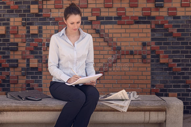 Young businesswoman sitting in a foyer stock images