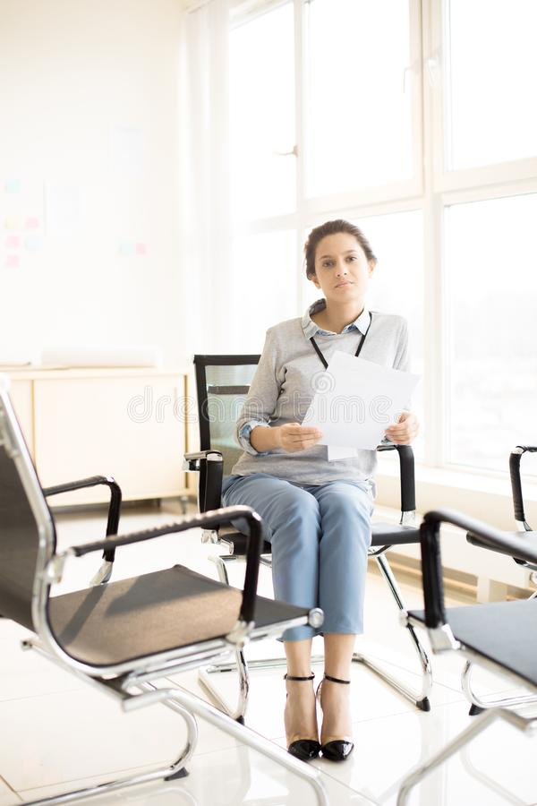 Young businesswoman sitting in office stock photos