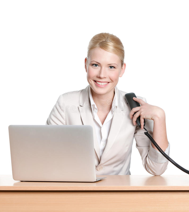 Download Young Businesswoman Sitting With Phone Handset Stock Photo - Image: 26597648
