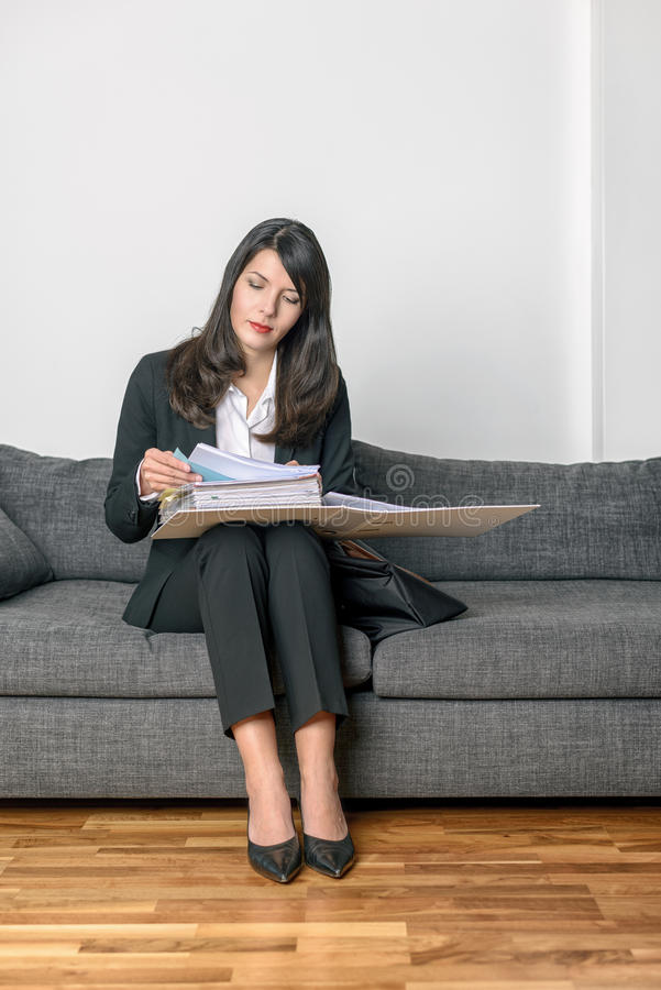 Young businesswoman sitting reading her notes royalty free stock images