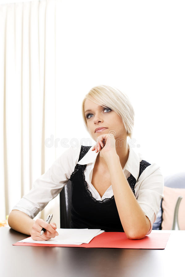 Download Young Businesswoman Sitting Thinking Stock Photo - Image: 33550842