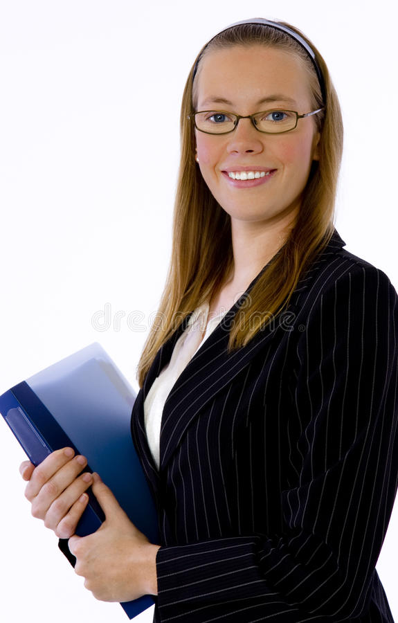 Young businesswoman smiles confidently at camera stock photography