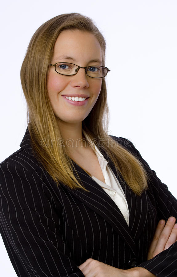 Young businesswoman smiles confidently at camera stock images