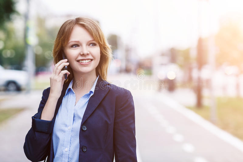 Young businesswoman speak on the phone stock photos