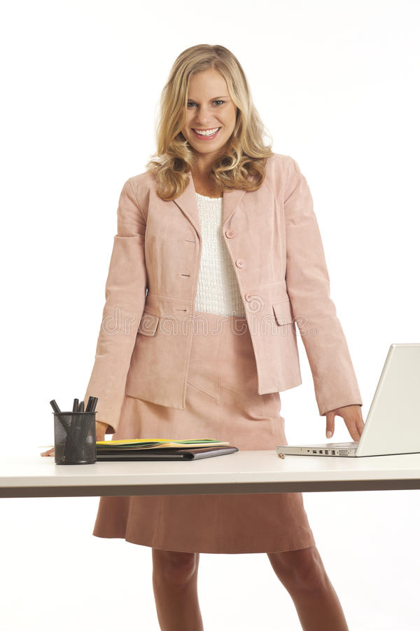 Young Businesswoman Standing At Desk Stock Photos