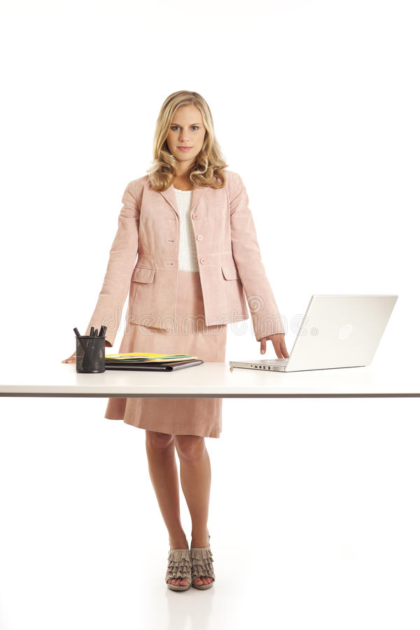 Young businesswoman standing at desk