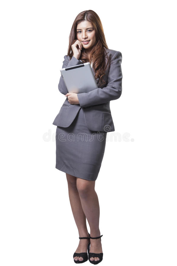 Young businesswoman standing holding digital tablet stock photo